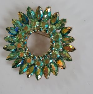 Gorgeous vintage crystal greens circle brooch